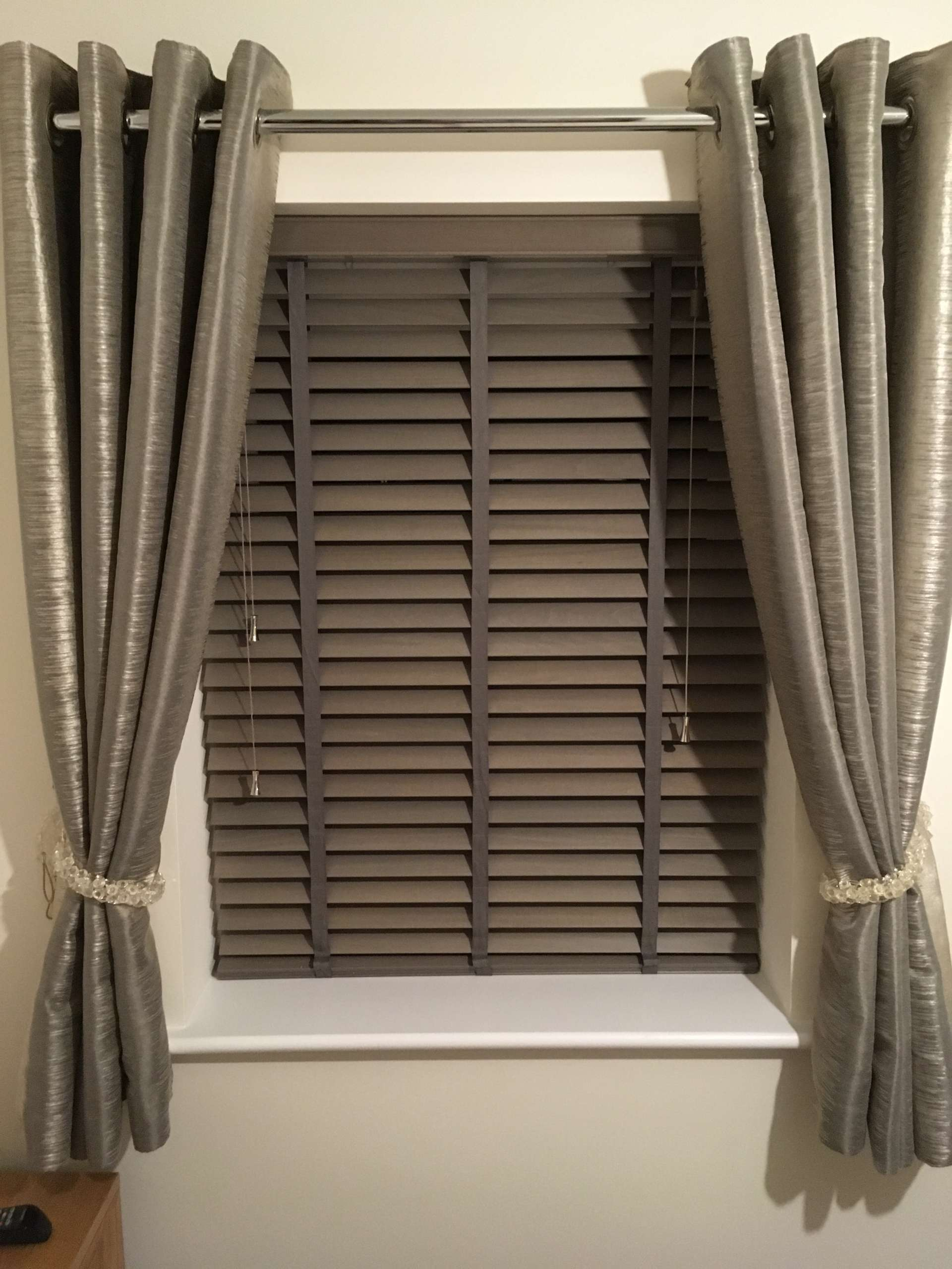 silver curtains and blinds
